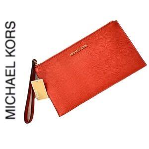 NWT authentic MK genuine leather wristlet orange